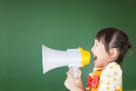 to announce: happy kid shouts something into the megaphone