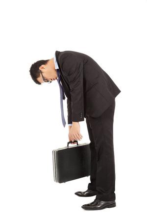 unconcerned: hombre de negocios agotado escalinata y la celebraci�n de malet�n
