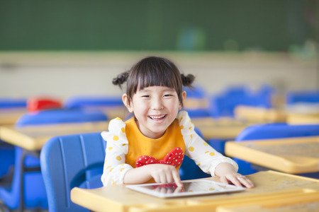 smiling kid using tablet  photo