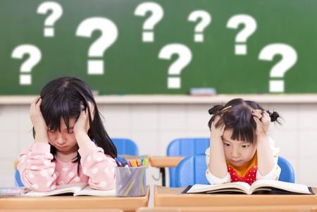 two kids is full of questions in class photo