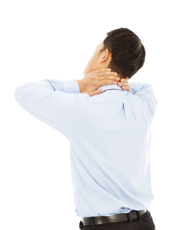 businessman holding his neck with pain photo