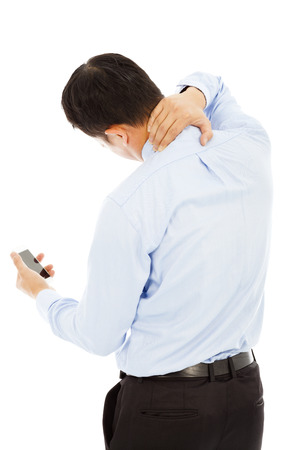 shoulder problem: businessman holding a phone and her neck with pain