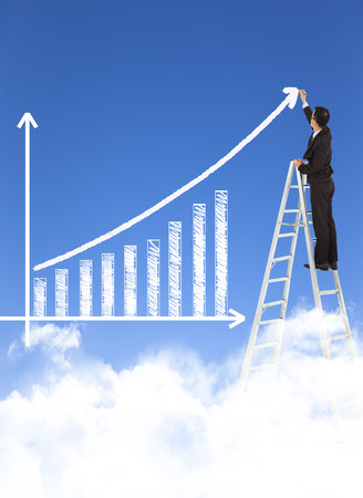 business man writing growth bar chart with sky background Banco de Imagens