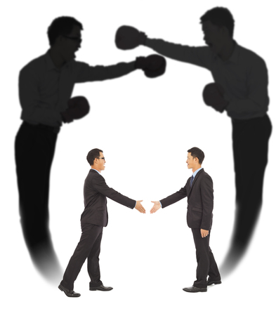 Asian businessman handshake with fighting shadow photo