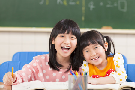 draw: happy little girls in the classroom