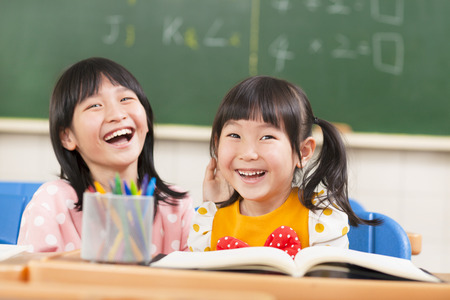 lovely childrens in the classroom Stock Photo - 27065887