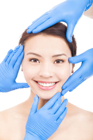Beautiful woman make a cosmetic operation photo