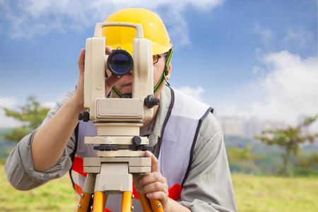 tacheometer: Surveyor engineer making measure in outdoor