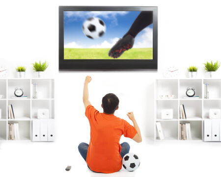 happy fan watching soccer game and raised hands photo