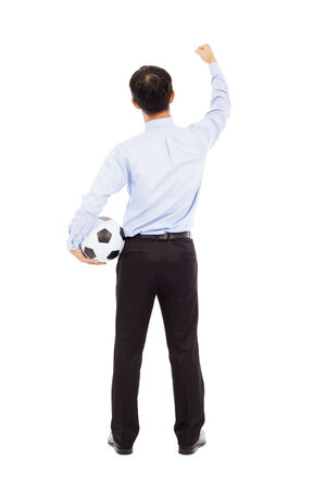 exclaim: Back view of young businessman hold a ball Stock Photo