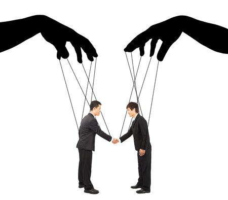 black hands shadow control two businessman actions photo