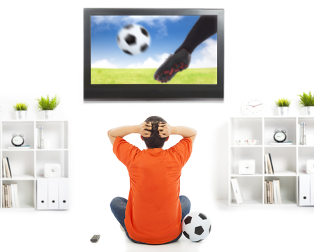 legs around:  fan watching soccer game and feeling nervous