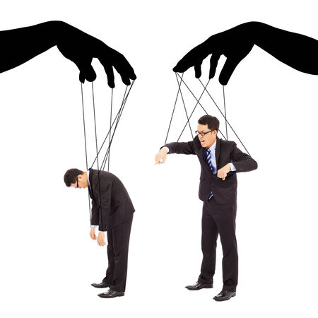 shadow puppet: black hands shadow control two businessman actions