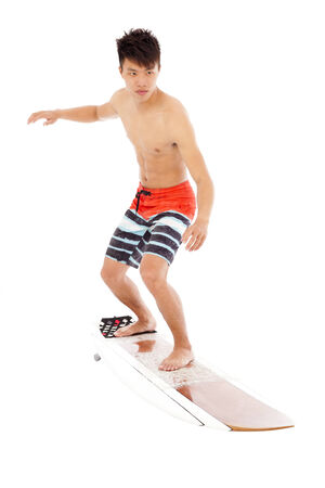 simulate: young  surfer simulate surfing pose
