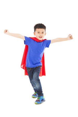superhero kid standing in studio photo