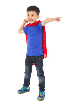 kid pointing: happy superhero kid pointing and ready to fight