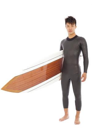 surfboard fin: surfing man  holding surfing board in studio