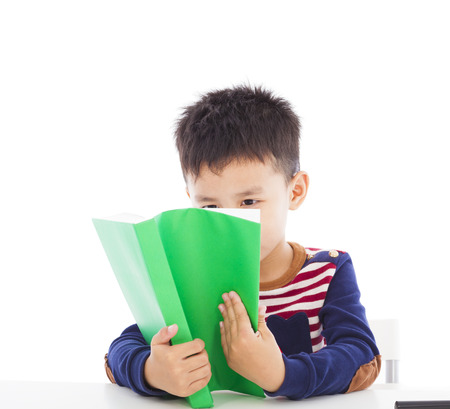 Asian kid reading a book photo