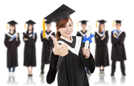 academic robe: pretty graduation student thumb up with classmates