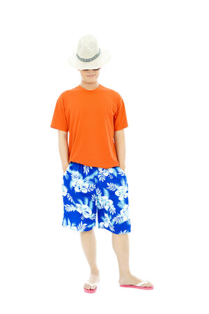 swimming shorts: young man standing and looking down Stock Photo