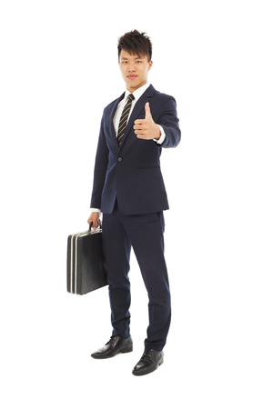 suit case: young businessman holding a briefcase and thumb up