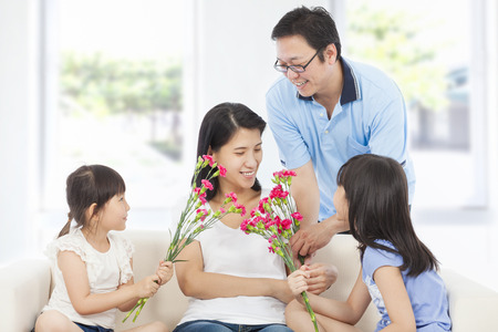 Daughters and father celebrating mothers day Stock Photo
