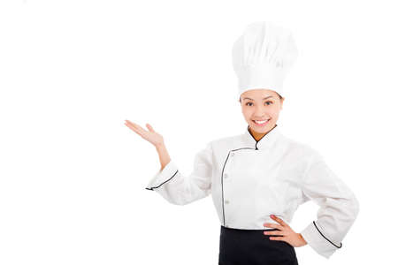 professional female cook raise hands to show something  photo