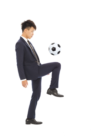 businessman is kicking a soccer photo
