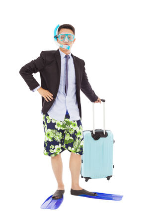 amused: businessman standing and holding a  baggage