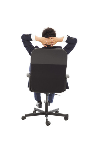 relaxing successful businessman leaning back   photo