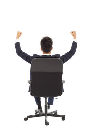 successful businessman with hands up photo