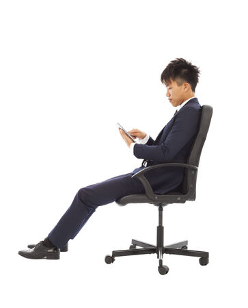 businessman using tablet pc on the chair photo