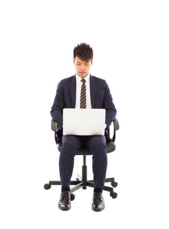 businessman using laptop on the chair photo