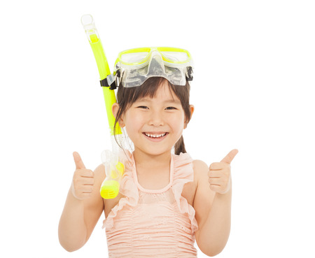 happy  little girl wearing swimsuit with thumb up photo