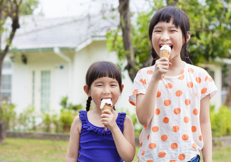 Cute little Girls  Eating Ice Cream photo