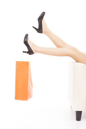 beautiful Womans legs and shopping bag photo