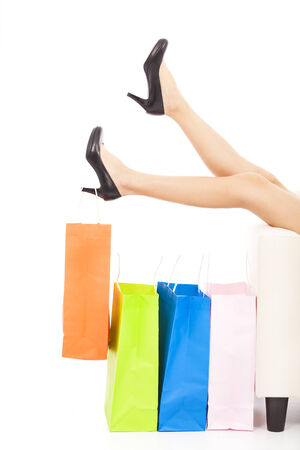 beautiful Womans legs and shopping bags photo