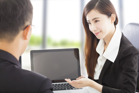 smiling Business woman presenting and explaining a project  Stock Photo