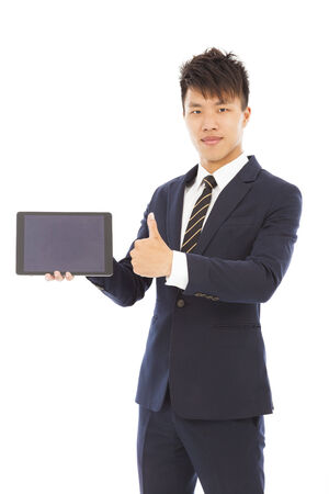 businessman holding a tablet or ipad and thumb up photo