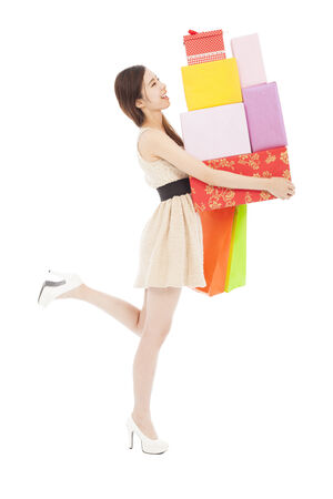 happy young woman holding gift box and shopping bag photo