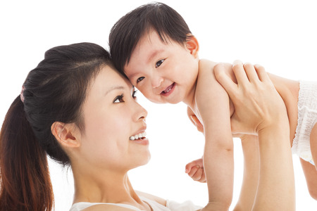 Happy  mother holding adorable child baby boy Stock Photo - 27941367