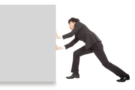 Young businessman pushing a blank board on white background photo