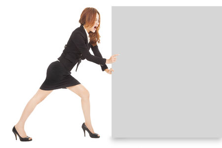 Young businesswoman pushing a blank board on white background Stock Photo - 27997575
