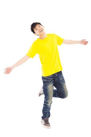 asian model: Full length of stylish young man dancing