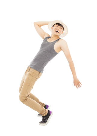 imitate: young man imitate  dancing pose and  holding a hat Stock Photo