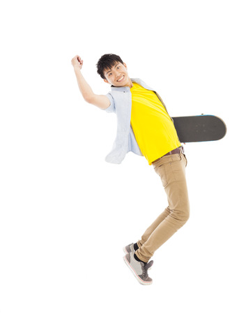 Vibrant young man holding a skateboard Stock Photo