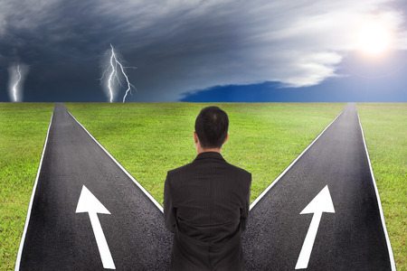 way of thinking: Businessman thinking to choice in between thunder and sunny way