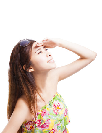 young woman raising hand to cover sunlight  photo