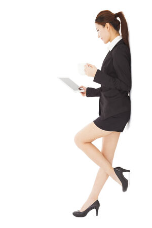 young businesswoman holding tablet and cups  photo