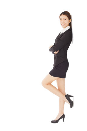 young businesswoman standing and across arms  photo